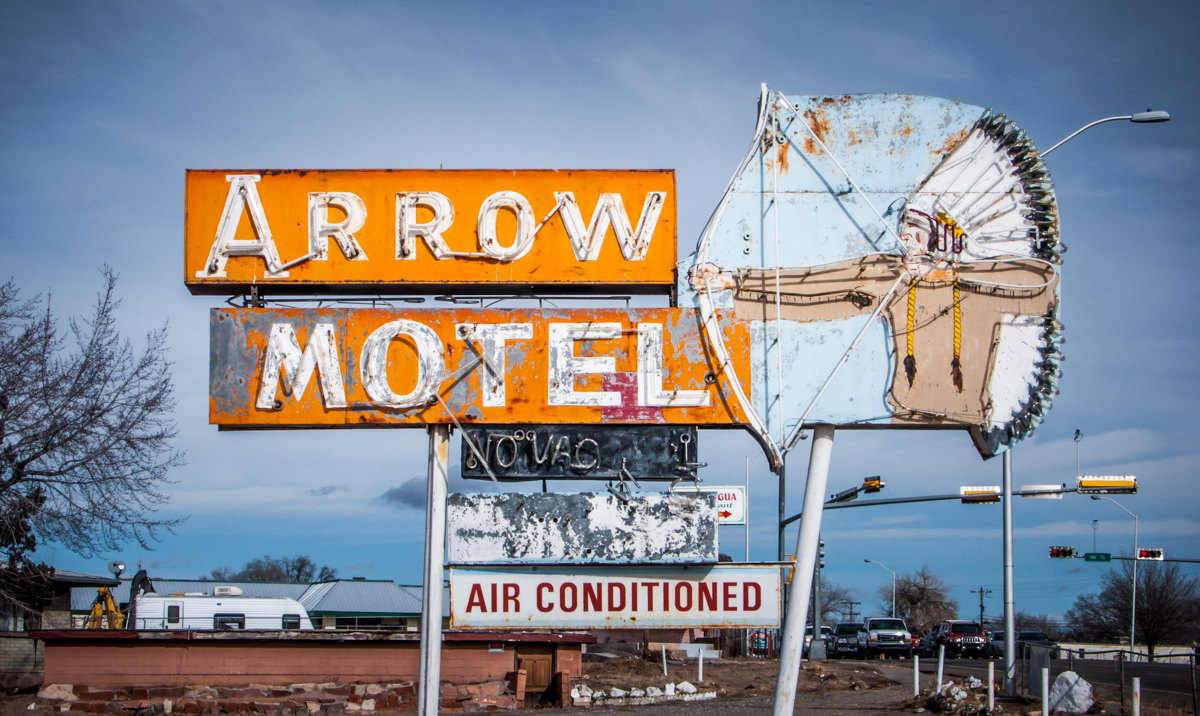 The Arrow Motel, in Española, NM, was still standing as of late 2016, but the doors to the rooms were replaced with plywood long ago.