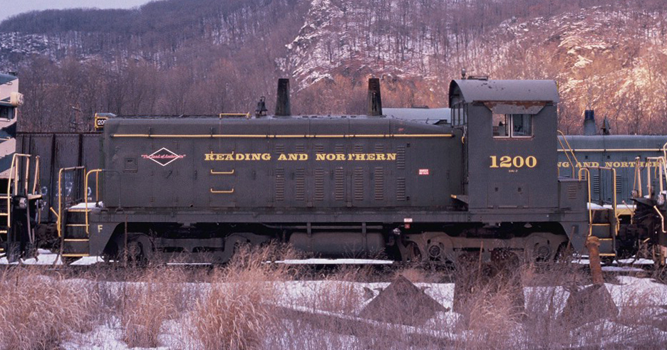 Repainted into a later Reading, Blue Mountain & Northern scheme, the #1200 sits in a deadline in Pittston, PA awaiting disposition on December 12, 2002. (Matt Provenza photo)