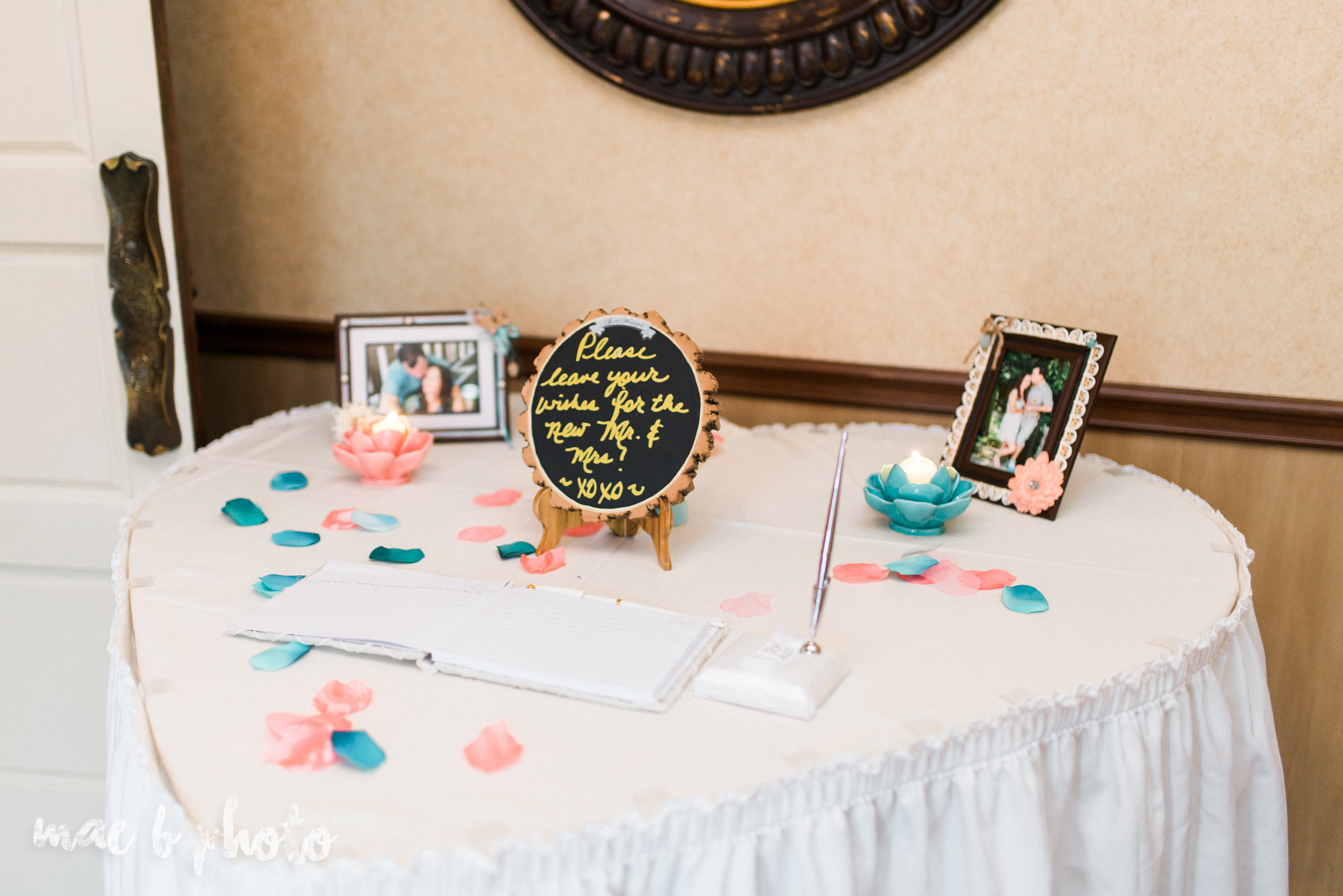 kristy and matt's summer wedding at the embassy in youngstown ohio photographed by youngstown wedding photographer mae b photo-32.jpg