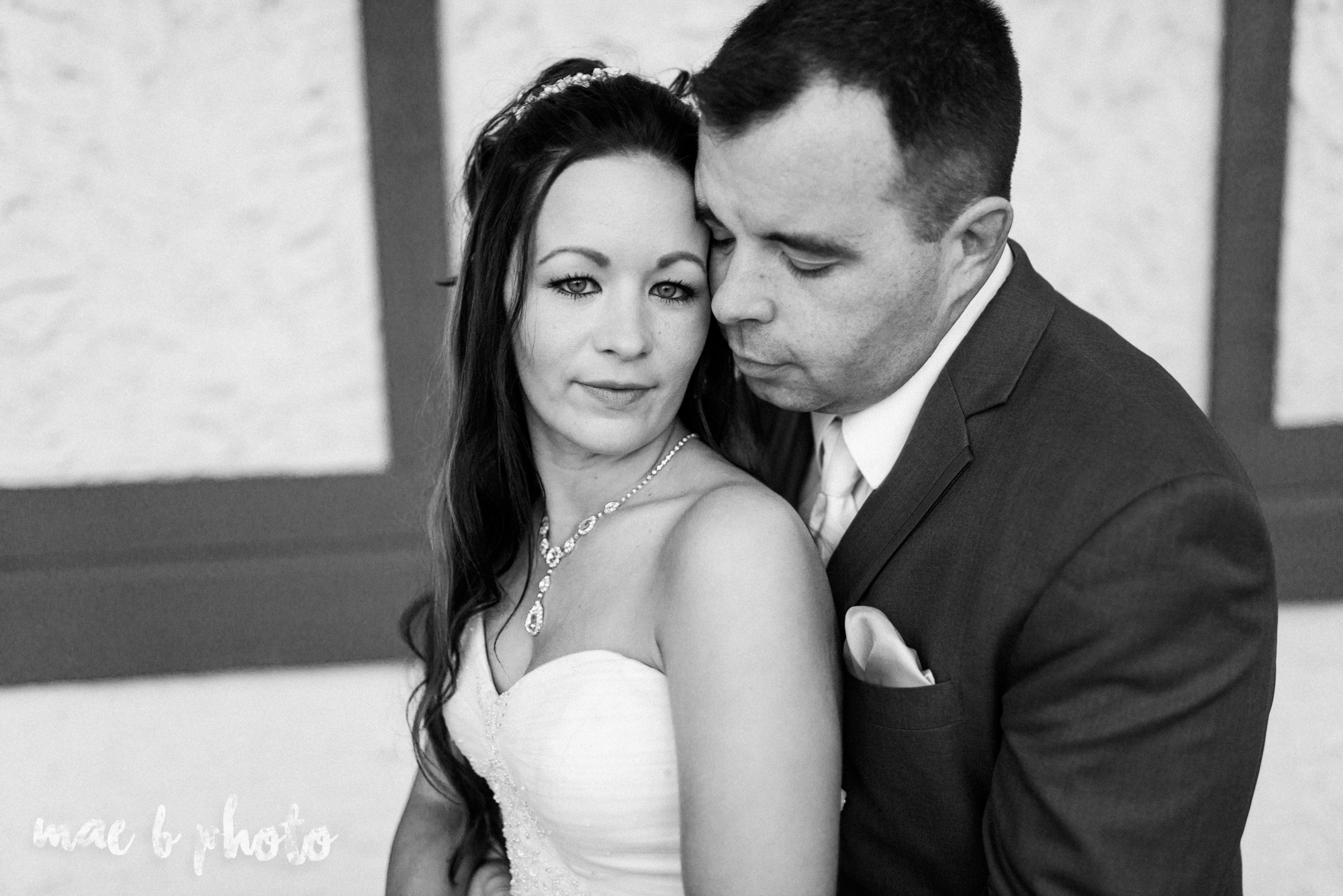 kristy and matt's summer wedding at the embassy in youngstown ohio photographed by youngstown wedding photographer mae b photo-19.jpg