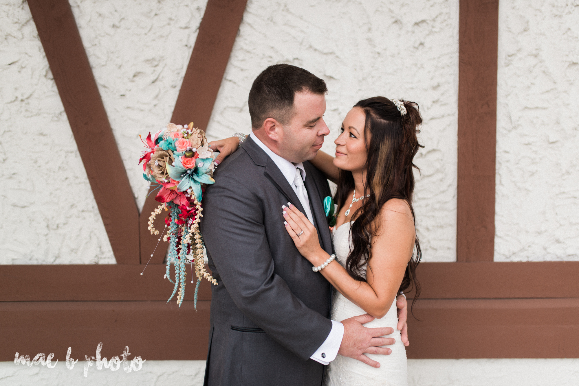 kristy and matt's summer wedding at the embassy in youngstown ohio photographed by youngstown wedding photographer mae b photo-14.jpg