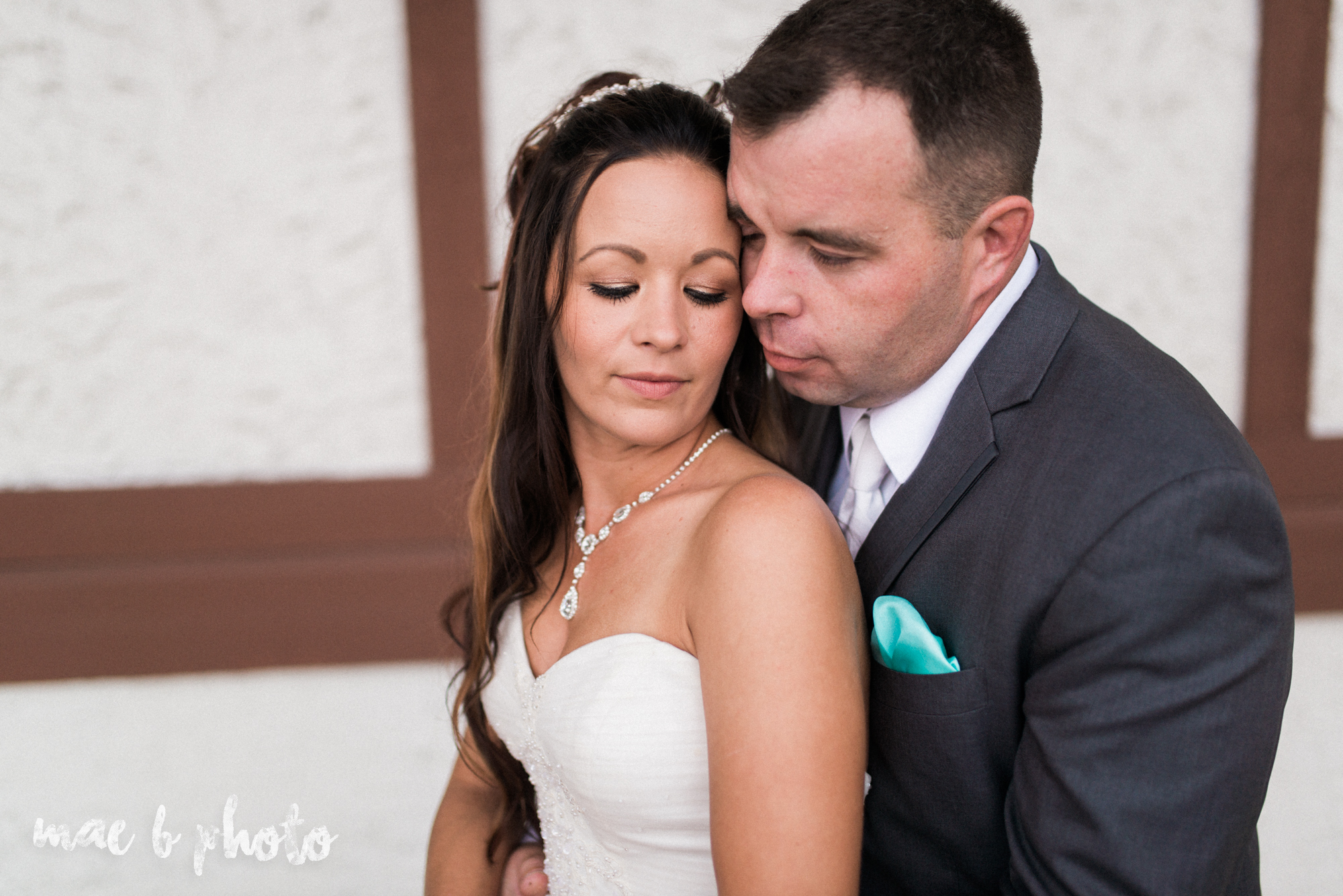 kristy and matt's summer wedding at the embassy in youngstown ohio photographed by youngstown wedding photographer mae b photo-18.jpg