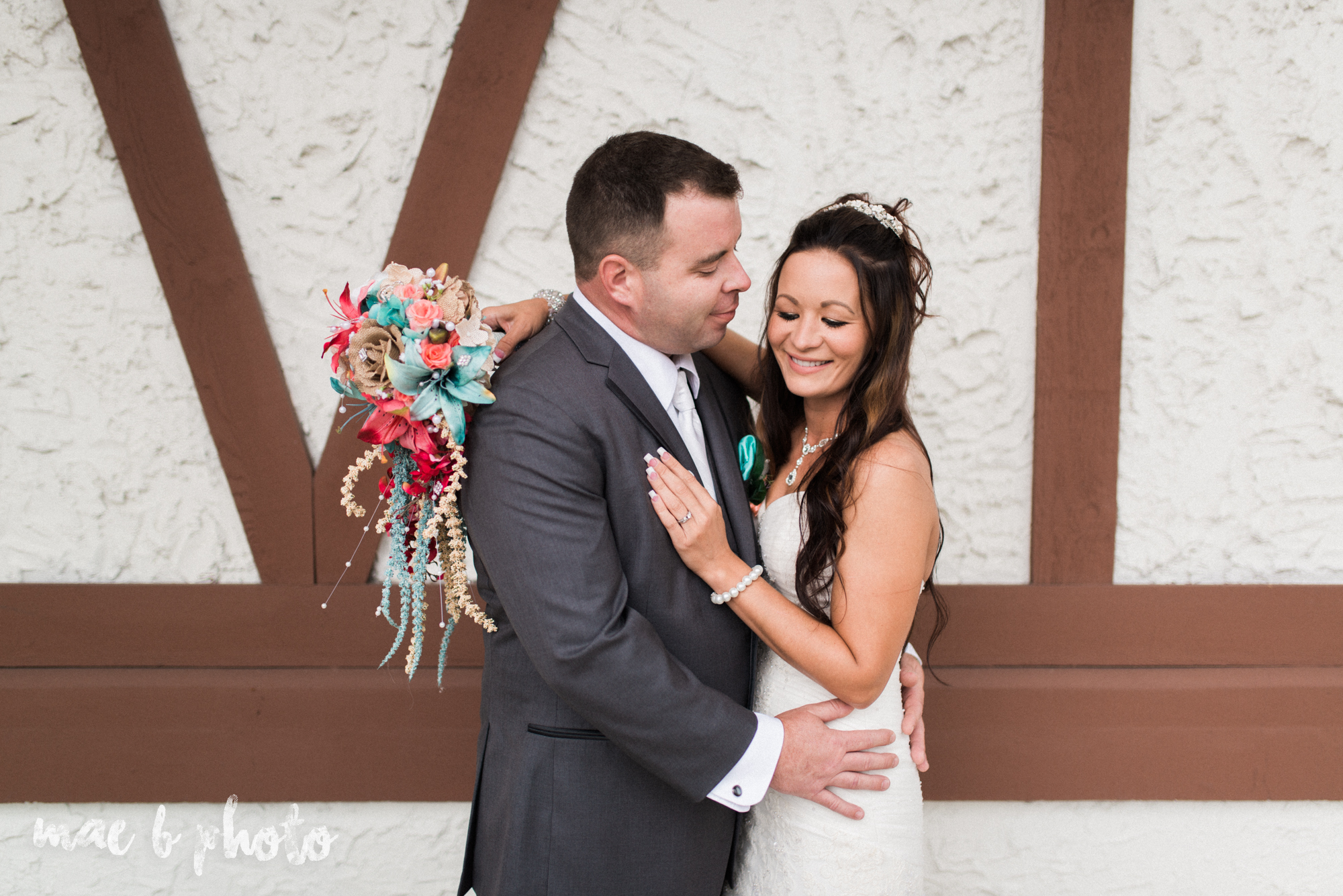 kristy and matt's summer wedding at the embassy in youngstown ohio photographed by youngstown wedding photographer mae b photo-13.jpg