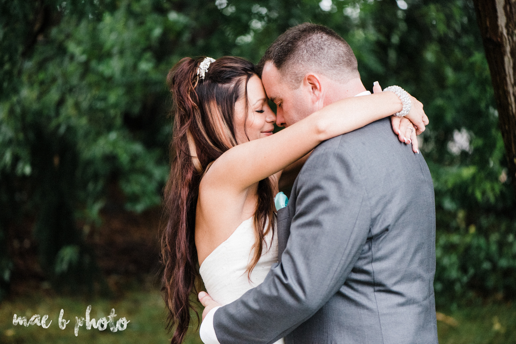kristy and matt's summer wedding at the embassy in youngstown ohio photographed by youngstown wedding photographer mae b photo-29.jpg
