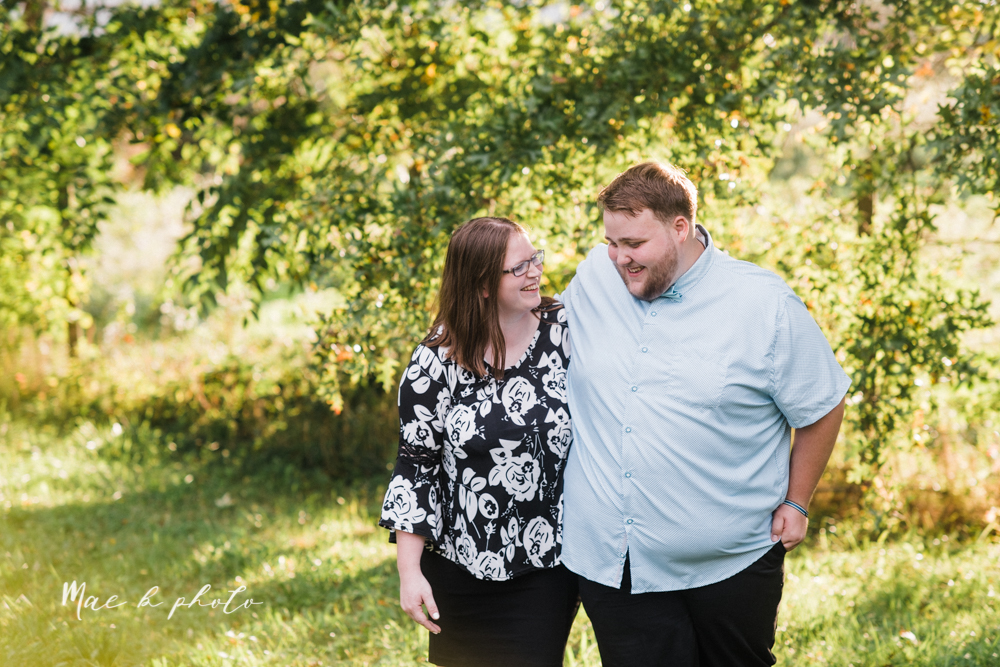 delorean and chase's backyard fall engagement session with youngstown state university shirts and a rescue dog from the mahoning county dog pound photographed by youngstown wedding photographer mae b photo-18.jpg
