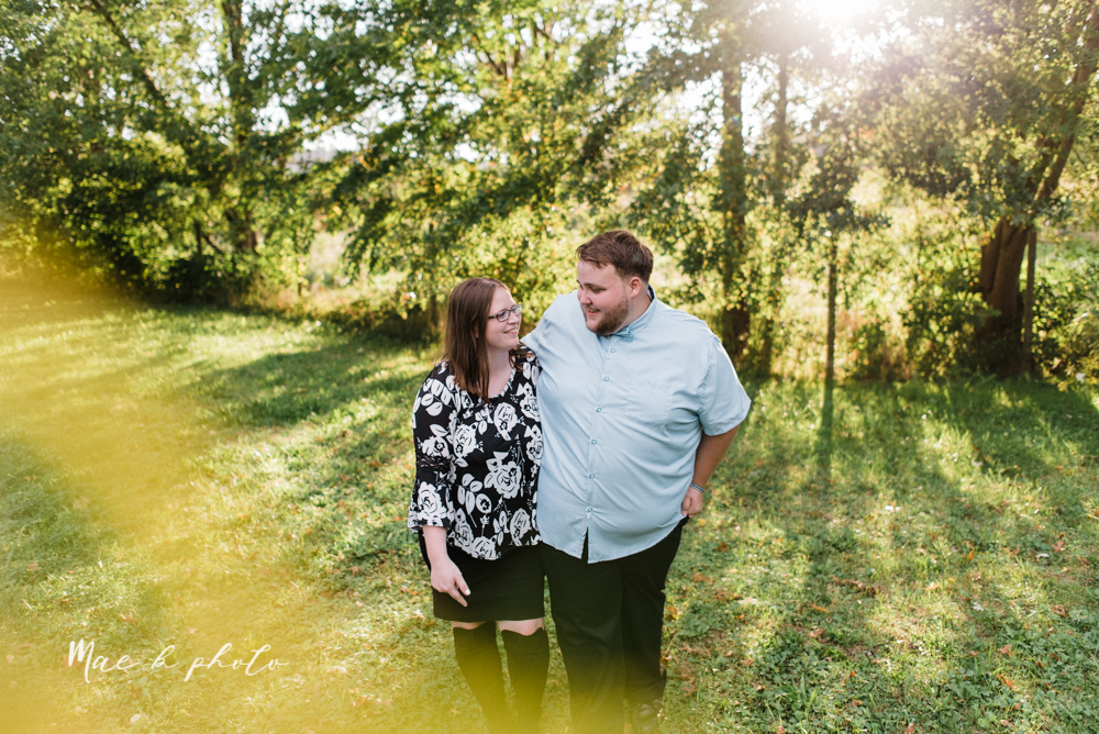 delorean and chase's backyard fall engagement session with youngstown state university shirts and a rescue dog from the mahoning county dog pound photographed by youngstown wedding photographer mae b photo-20.jpg
