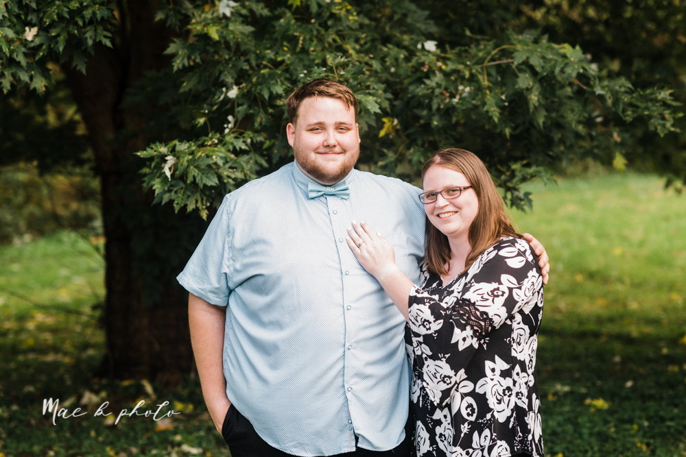 delorean and chase's backyard fall engagement session with youngstown state university shirts and a rescue dog from the mahoning county dog pound photographed by youngstown wedding photographer mae b photo-1.jpg