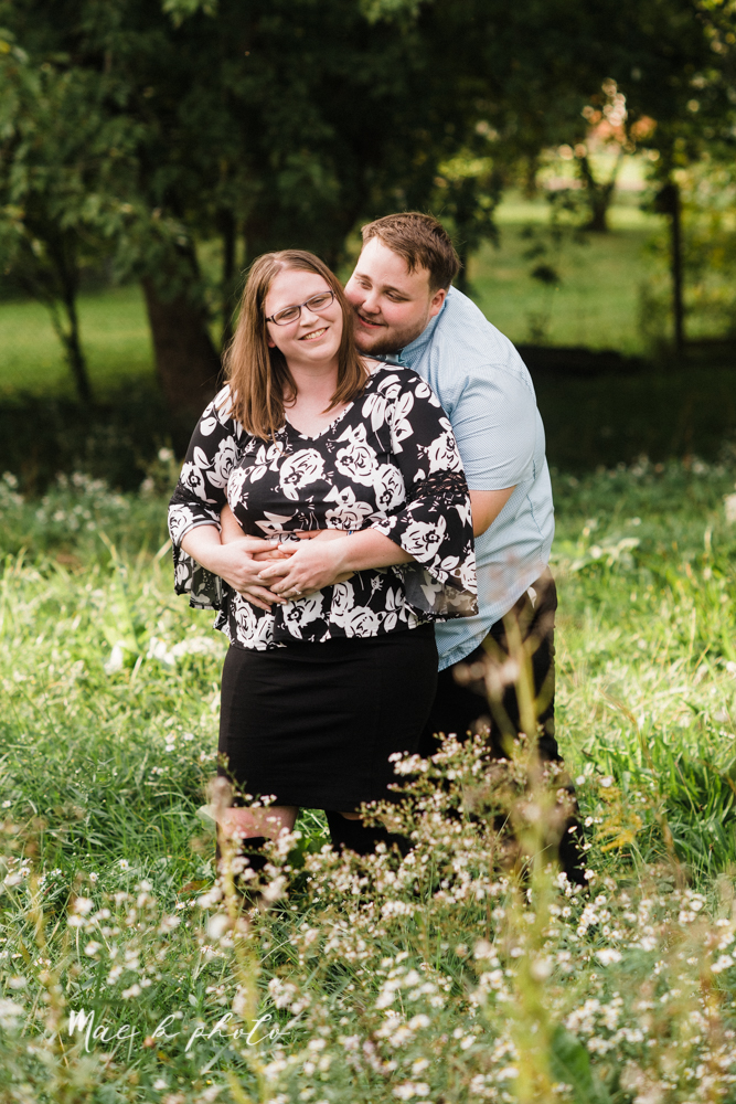 delorean and chase's backyard fall engagement session with youngstown state university shirts and a rescue dog from the mahoning county dog pound photographed by youngstown wedding photographer mae b photo-9.jpg