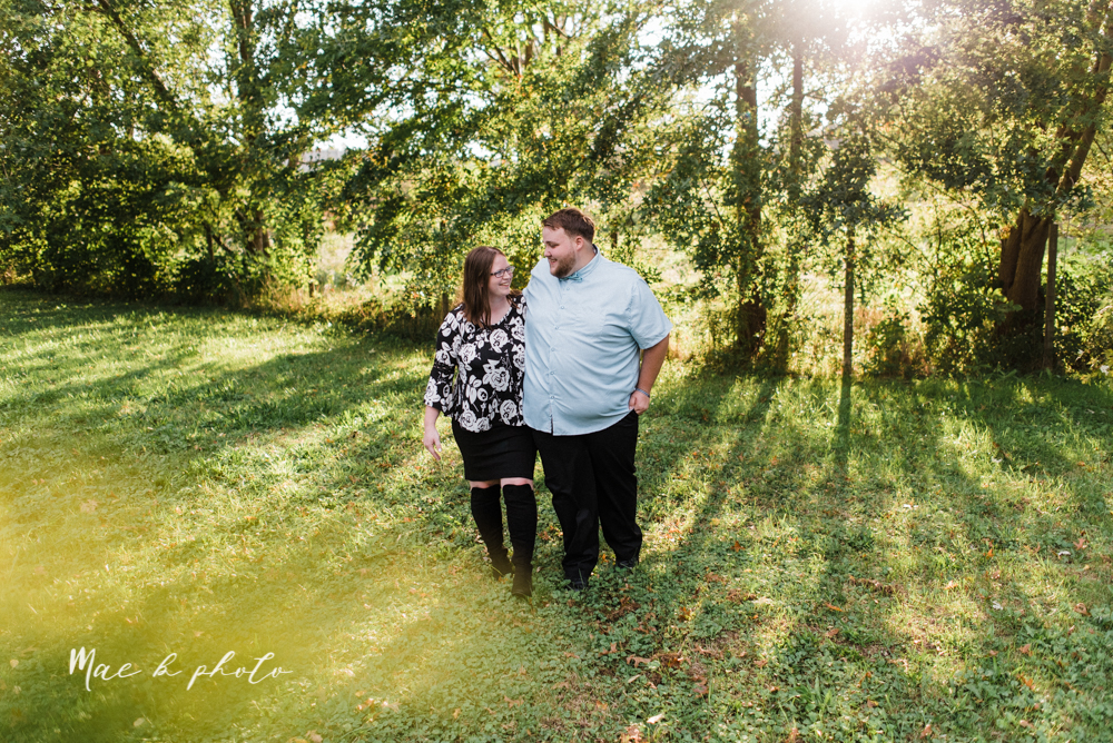 delorean and chase's backyard fall engagement session with youngstown state university shirts and a rescue dog from the mahoning county dog pound photographed by youngstown wedding photographer mae b photo-19.jpg