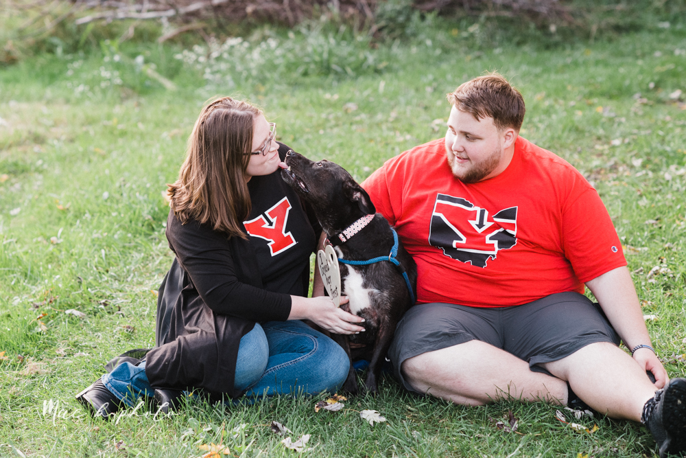 delorean and chase's backyard fall engagement session with youngstown state university shirts and a rescue dog from the mahoning county dog pound photographed by youngstown wedding photographer mae b photo-35.jpg