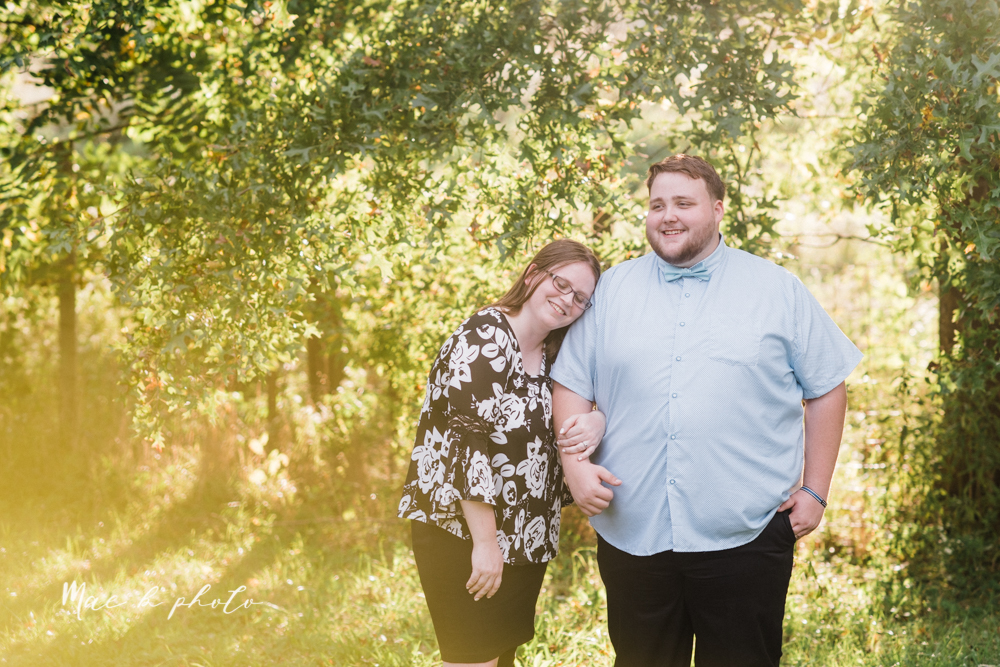 delorean and chase's backyard fall engagement session with youngstown state university shirts and a rescue dog from the mahoning county dog pound photographed by youngstown wedding photographer mae b photo-14.jpg