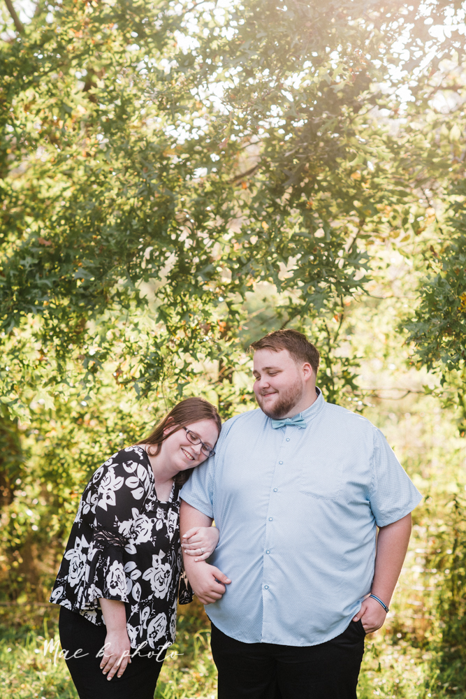 delorean and chase's backyard fall engagement session with youngstown state university shirts and a rescue dog from the mahoning county dog pound photographed by youngstown wedding photographer mae b photo-17.jpg
