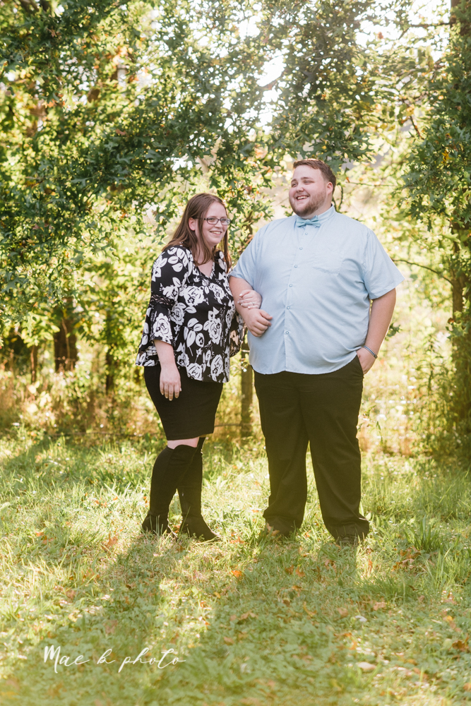 delorean and chase's backyard fall engagement session with youngstown state university shirts and a rescue dog from the mahoning county dog pound photographed by youngstown wedding photographer mae b photo-13.jpg