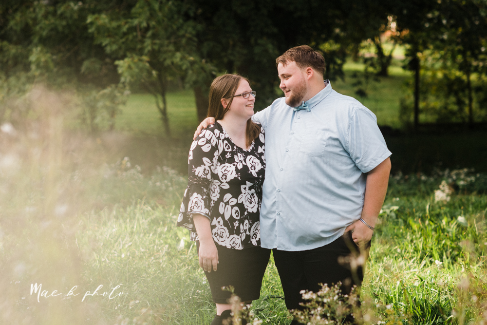 delorean and chase's backyard fall engagement session with youngstown state university shirts and a rescue dog from the mahoning county dog pound photographed by youngstown wedding photographer mae b photo-10.jpg