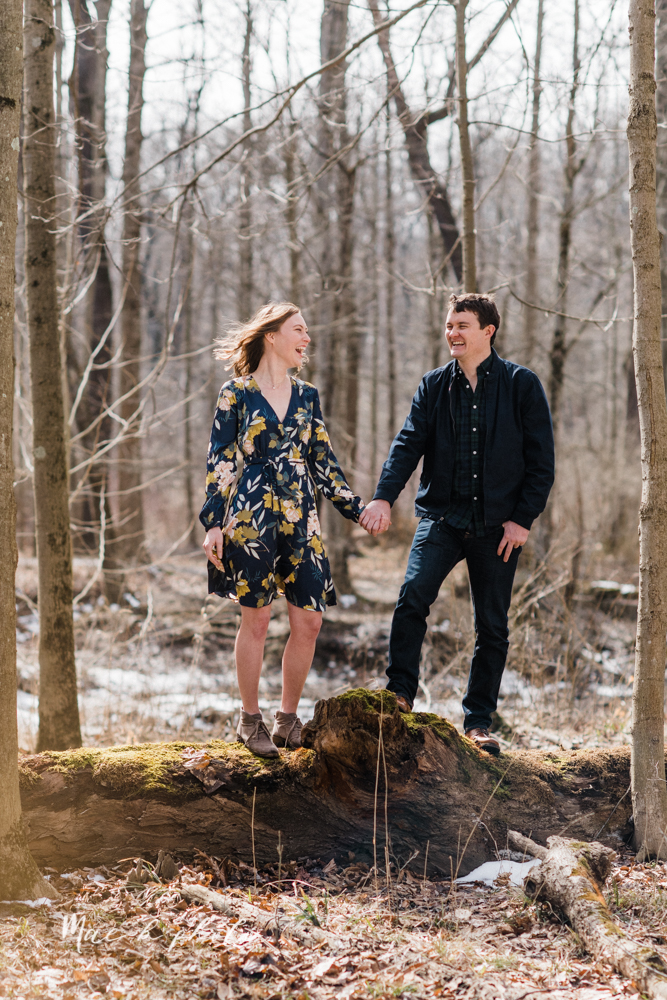 christina and michael's hometown woodsy playful early spring engagement session at poland forest in poland ohio and poland library and handels ice cream in canfield ohio photographed by youngstown wedding photographer mae b photo-31.jpg