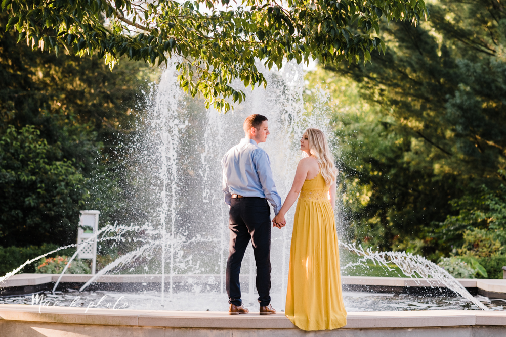 julie and jared's romantic summer garden engagement session at rivers fellowside gardens in mill creek park in the rose gardens in youngstown ohio photographed by youngstown wedding photographer mae b photo-39.jpg