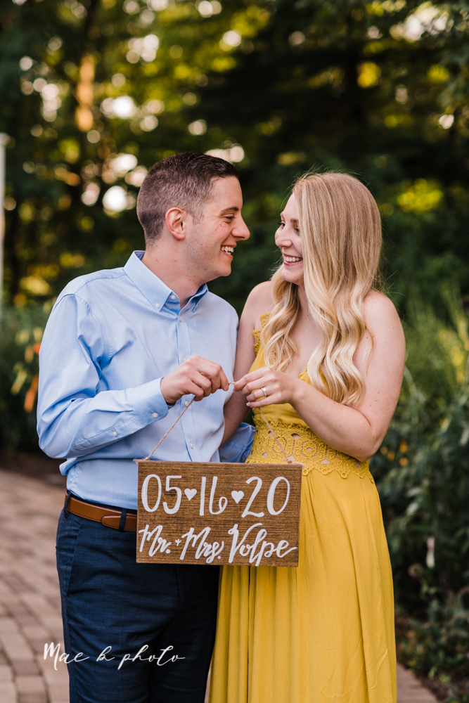 julie and jared's romantic summer garden engagement session at rivers fellowside gardens in mill creek park in the rose gardens in youngstown ohio photographed by youngstown wedding photographer mae b photo-6.jpg
