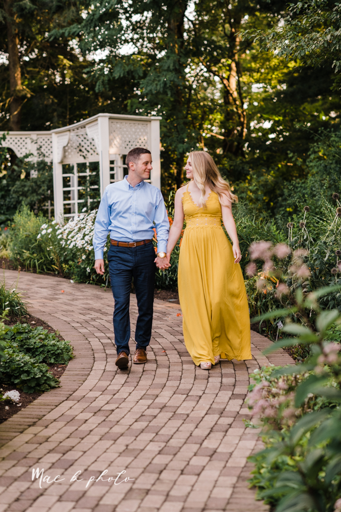 julie and jared's romantic summer garden engagement session at rivers fellowside gardens in mill creek park in the rose gardens in youngstown ohio photographed by youngstown wedding photographer mae b photo-7.jpg