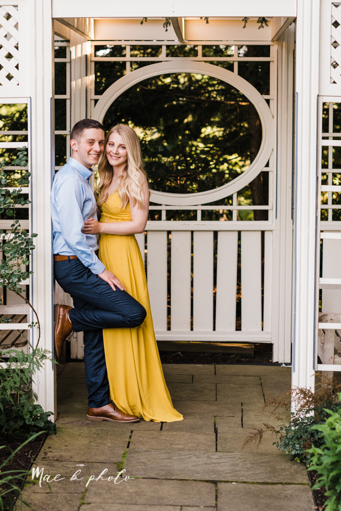 julie and jared's romantic summer garden engagement session at rivers fellowside gardens in mill creek park in the rose gardens in youngstown ohio photographed by youngstown wedding photographer mae b photo-15.jpg