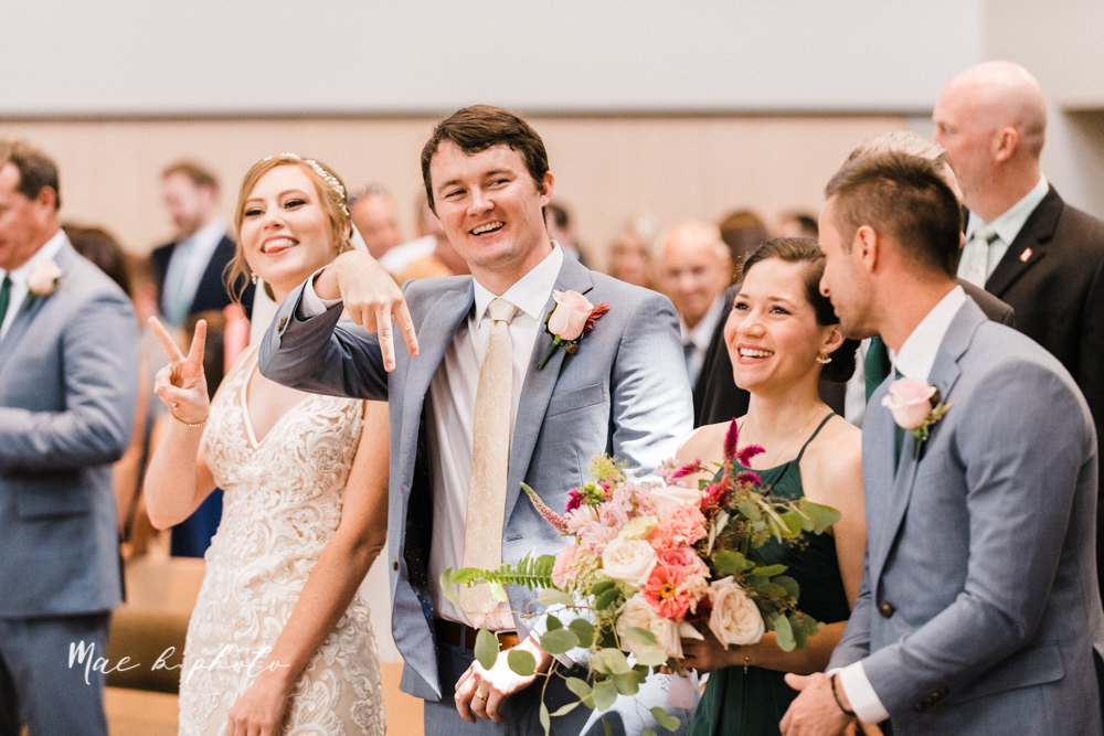 christina and michael's baseball themed midwest wedding at drake's landing and river's fellowside gardens in mill creek park in  youngstown ohio and holy family parish in poland ohio photographed by youngstown wedding photographer mae b photo-40.jpg