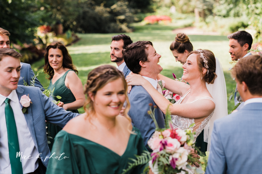 christina and michael's baseball themed midwest wedding at drake's landing and river's fellowside gardens in mill creek park in  youngstown ohio and holy family parish in poland ohio photographed by youngstown wedding photographer mae b photo-56.jpg