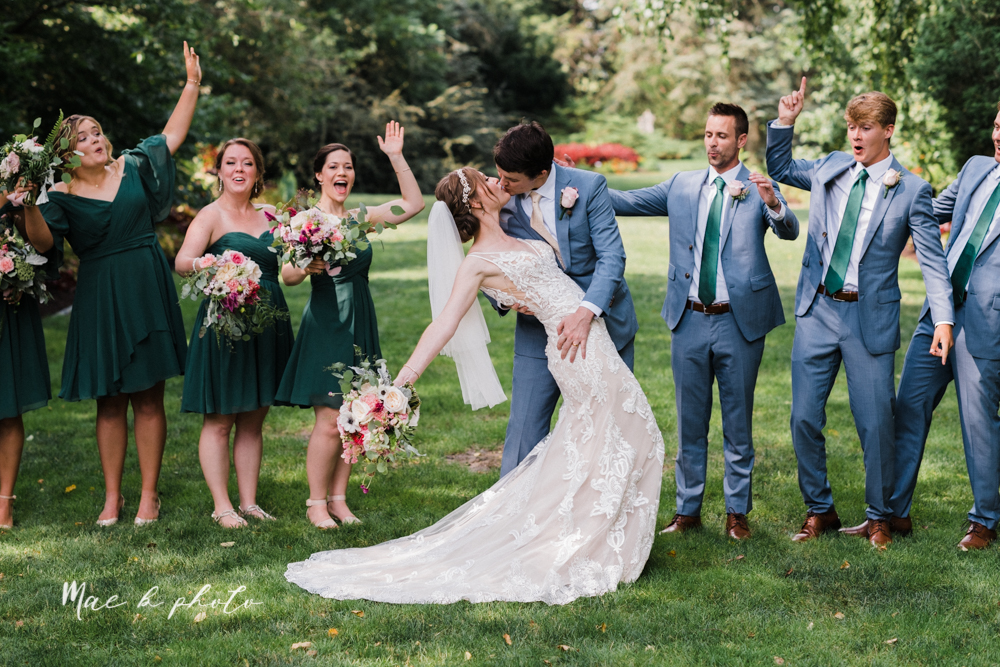 christina and michael's baseball themed midwest wedding at drake's landing and river's fellowside gardens in mill creek park in  youngstown ohio and holy family parish in poland ohio photographed by youngstown wedding photographer mae b photo-48.jpg