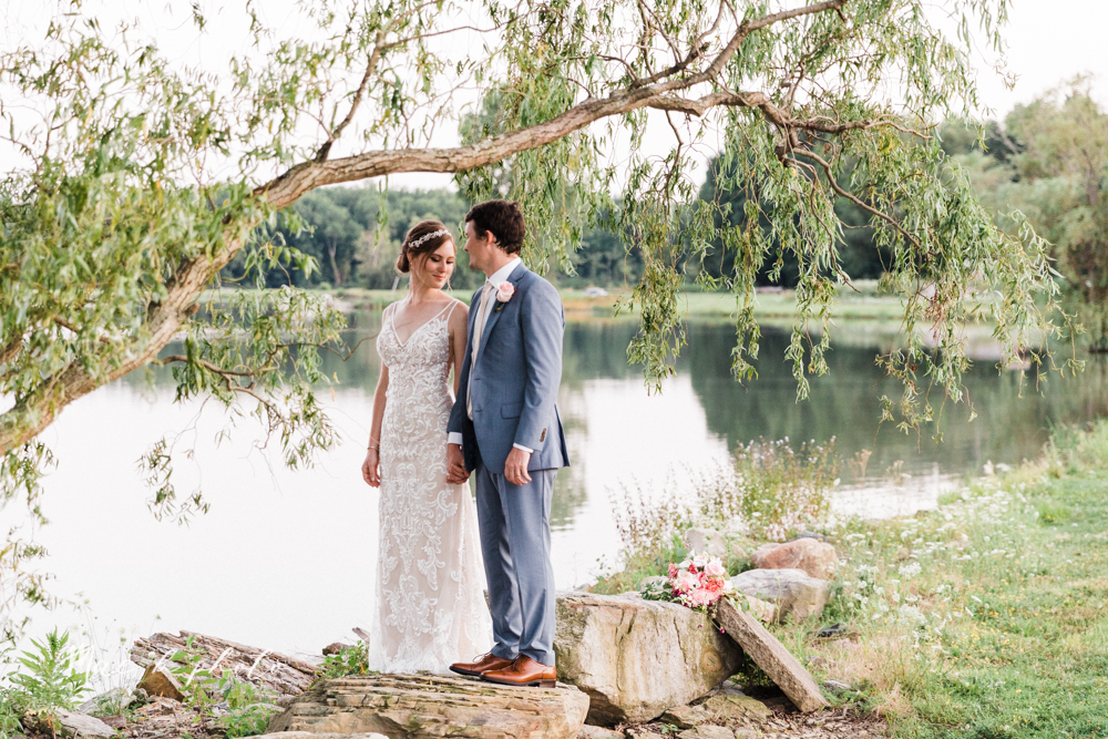 christina and michael's baseball themed midwest wedding at drake's landing and river's fellowside gardens in mill creek park in  youngstown ohio and holy family parish in poland ohio photographed by youngstown wedding photographer mae b photo-181.jpg
