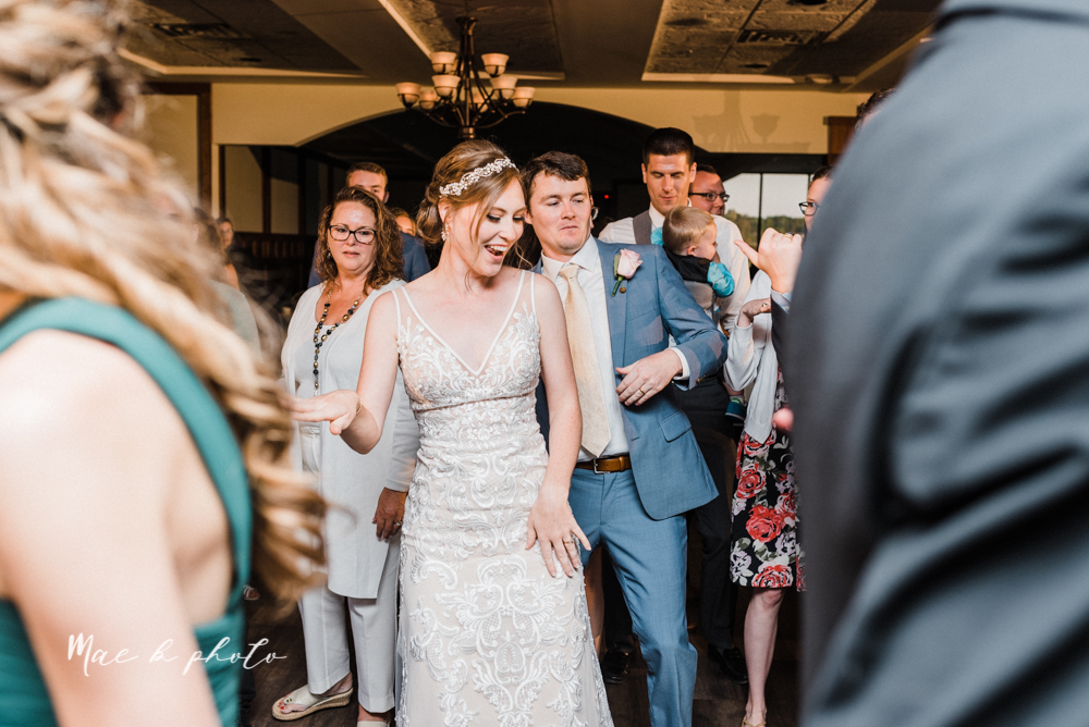 christina and michael's baseball themed midwest wedding at drake's landing and river's fellowside gardens in mill creek park in  youngstown ohio and holy family parish in poland ohio photographed by youngstown wedding photographer mae b photo-125.jpg