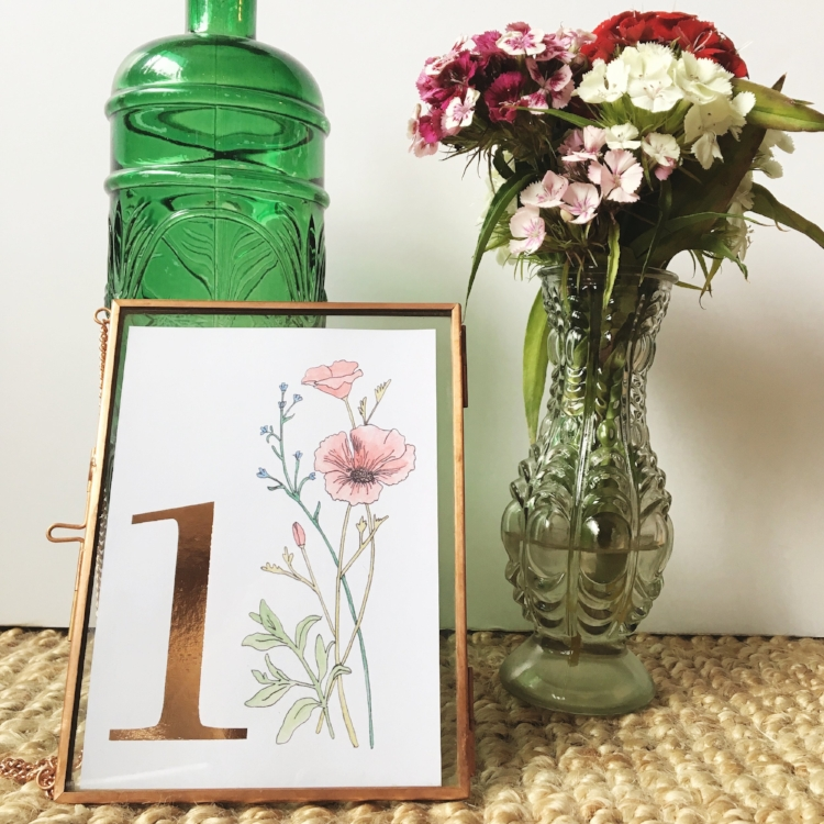 Hand illustrated wildflower table numbers with rose gold foil detailing.