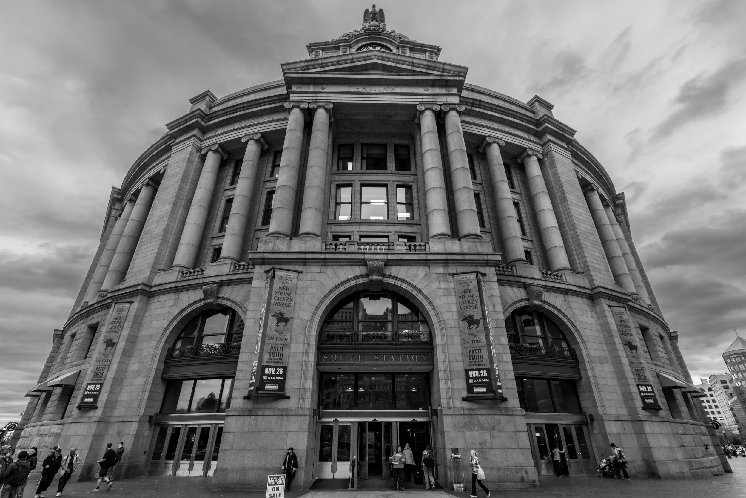 """A wide-angle lens with a short focal length is better suited to shrink a close-up portrait image such as the picture above depicting the south station is Boston. Image Credit: """" South Station, Boston [275/366] """" by  Tim Sackton  is licensed under  CC BY 2.0 ."""