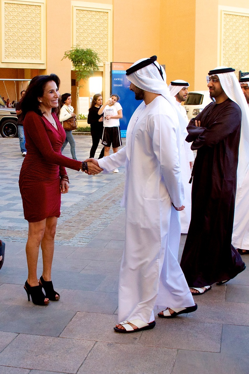Elise shows her art to the crown prince of Dubai