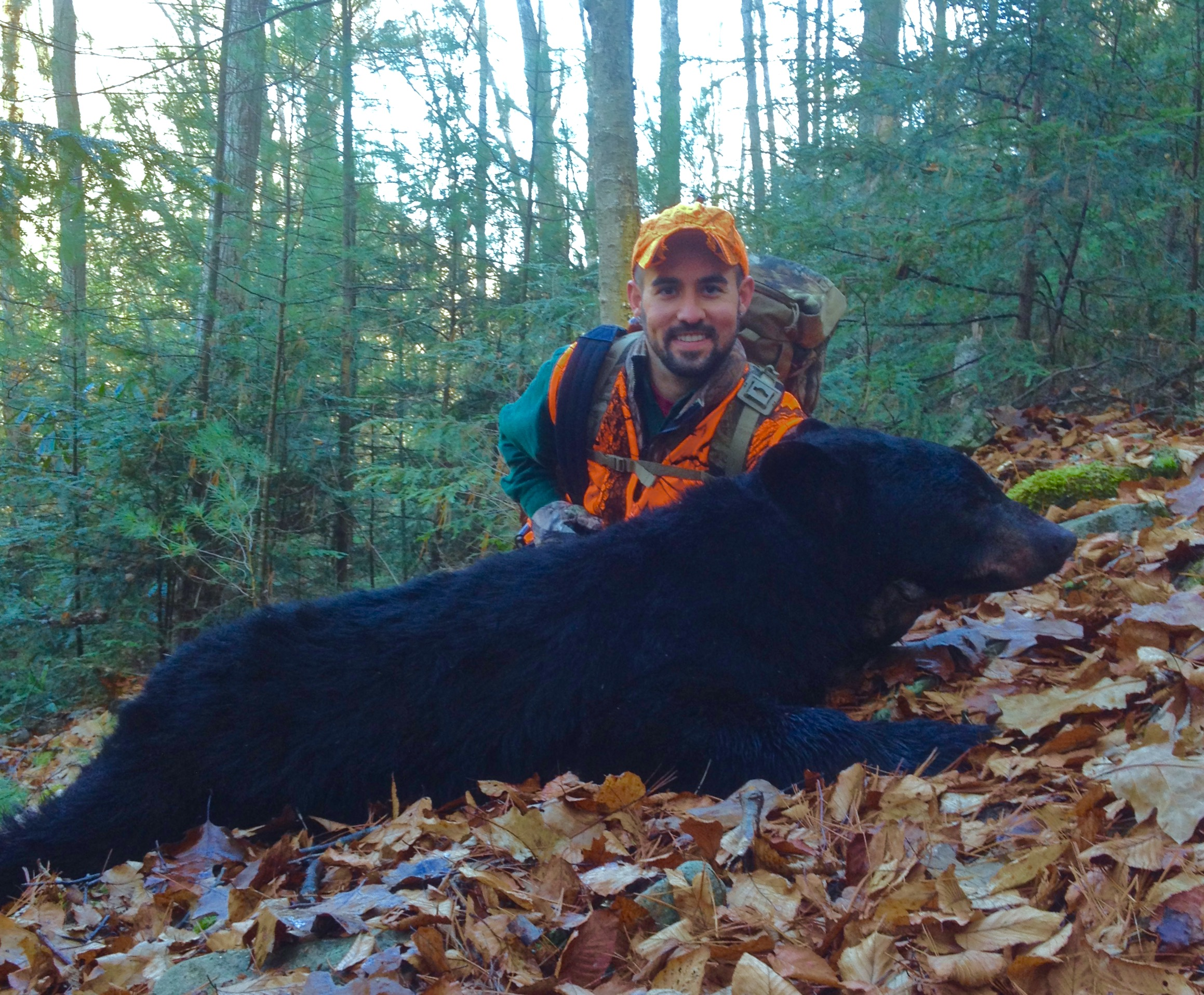 Tyler up in the mountains with the black bear