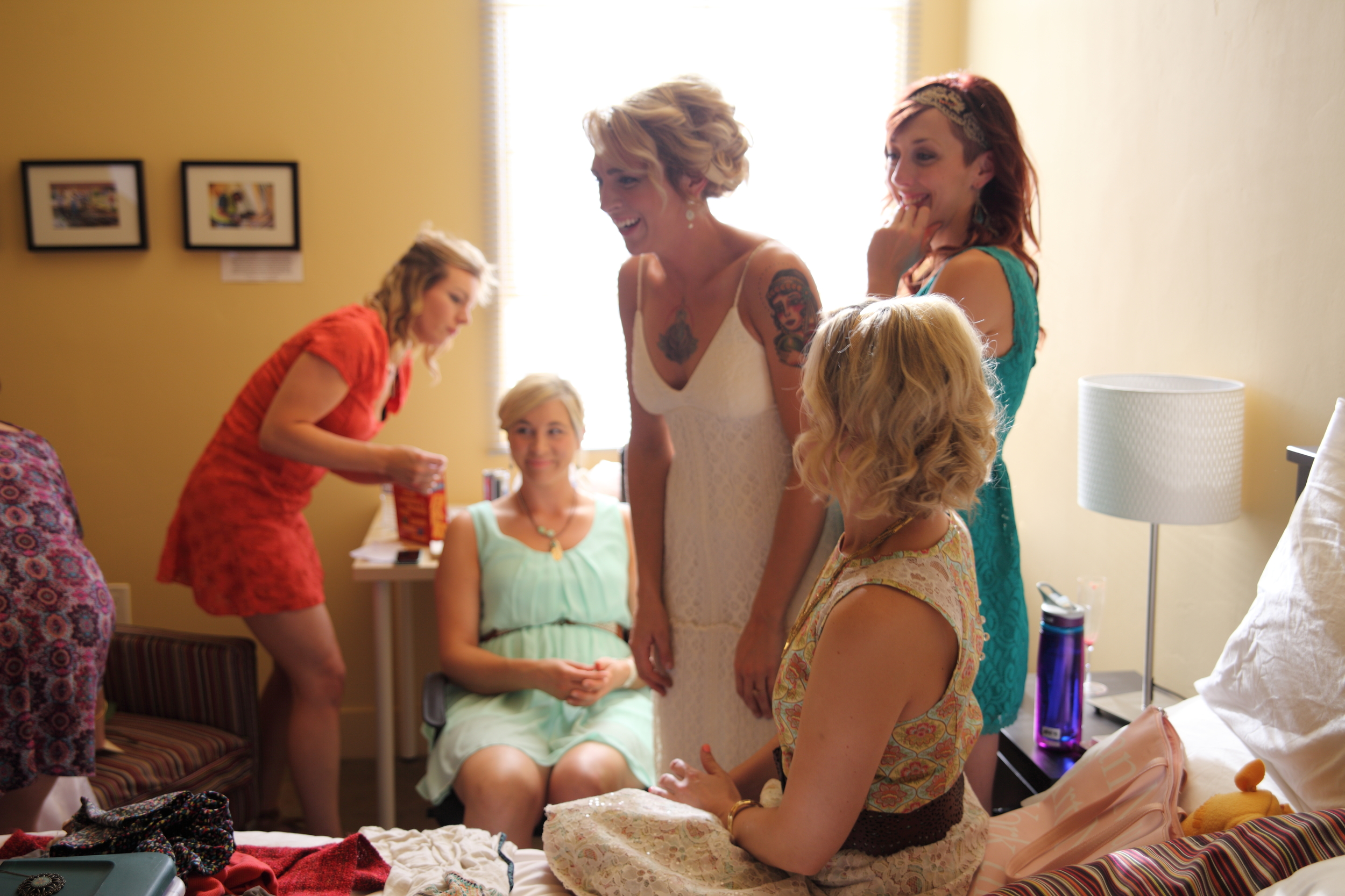 A bride and friends get ready for her wedding in one of our guest rooms