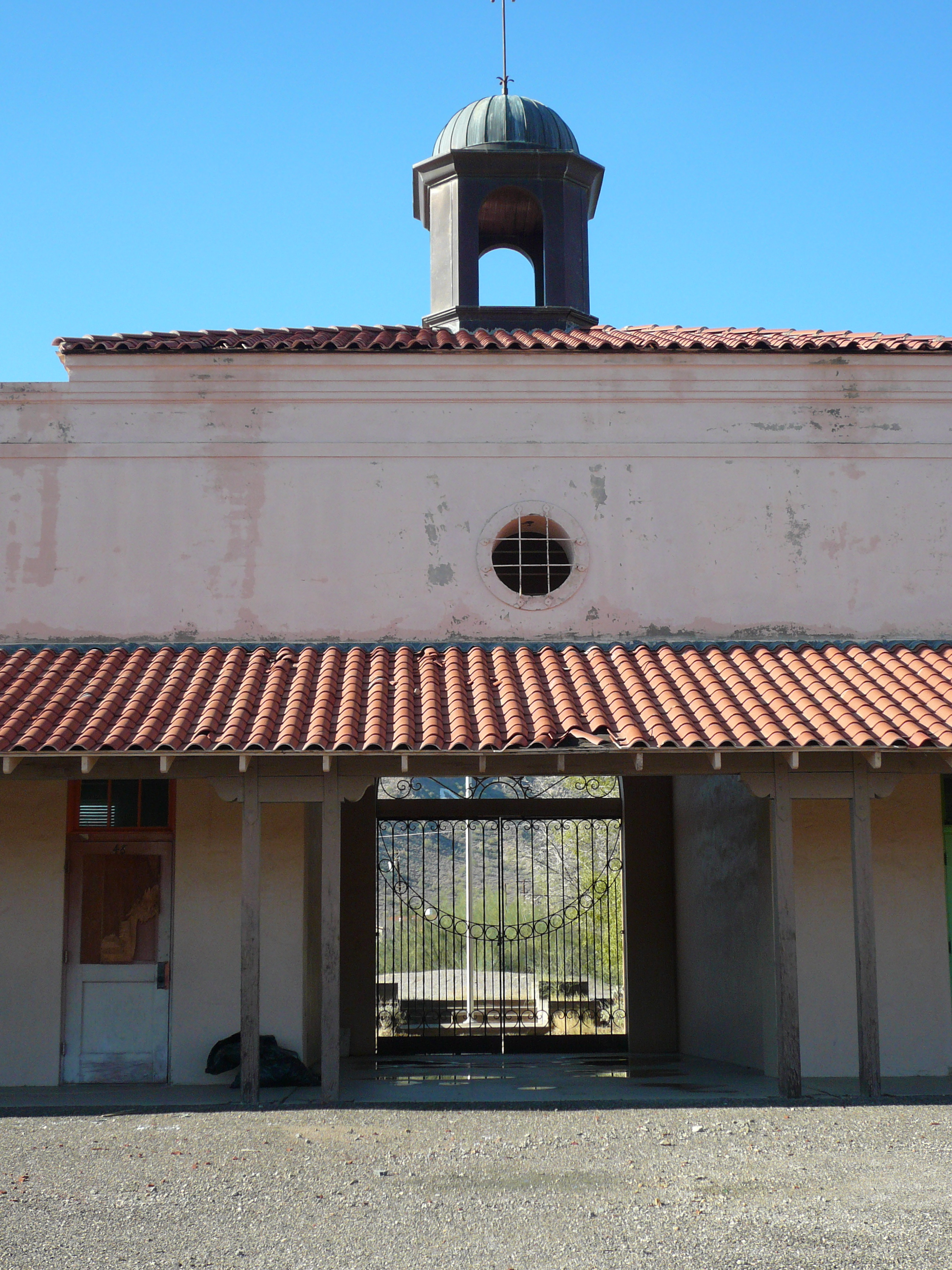 The main entrance before renovations. The stucco walls and tile roofs were all restored.