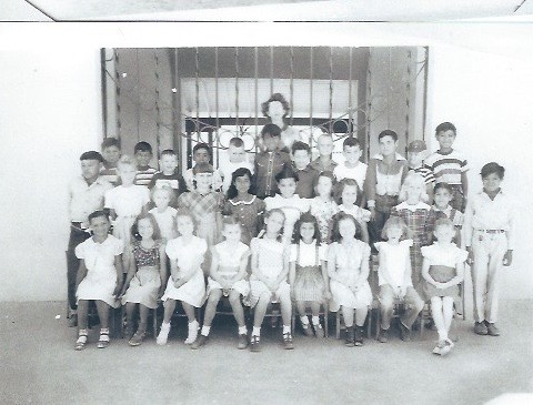 An old class picture taken by the front gate