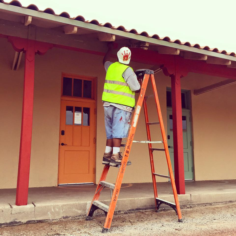 An apprentice putting the finishing touches on the South Wing during our opening season.