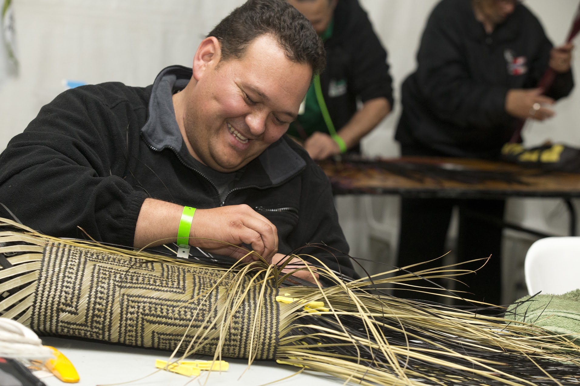 "Te Atiwei Ririnui - Te Atiwei Ririnui is a traditional Maori weaver from Auckland, New Zealand. His passion for weaving stems from a desire to keep the tradition alive so that the craft is not lost. During his residency he created a new Kete Whakairo (pattern basket) using materials native to New Zealand, with a complex Maori ""Stairway to Heaven"" weaving pattern. He also spent time with indigenous artists from Arizona and New Mexico to better understand why and how their art culture is important to them. Te Atiwei was in Ajo January 5-19, 2019.Upon returning to New Zealand, he wrote of his residency experience, ""The exhibit at the Arts Under the Arches was amazing to see… I was able to share stories of my works and how my time in Ajo had helped to shape my understanding of raranga from a Māori perspective by learning about the weaving techniques of the indigenous of Tohono O'odham.""Click here to see a recent video about Te Atiwei's work."