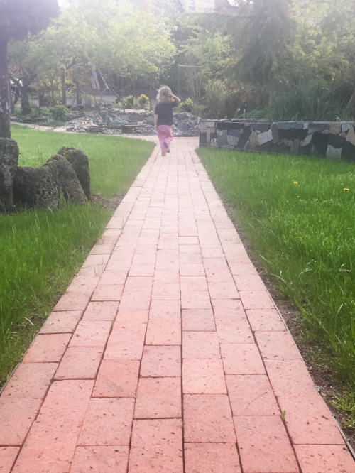 Stella running down the brick path at Baba & Papa's House this weekend.