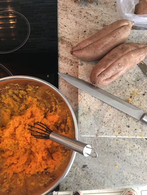 Remove meat from sweet potato and place in a large bowl.