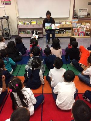 Usma Reading to Class.jpg