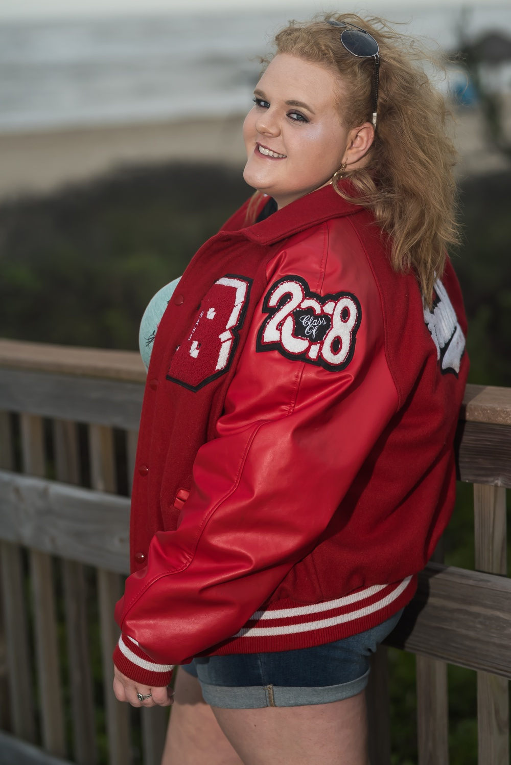 Creations by Jewel_Letterman jacket_Senior photos.jpg