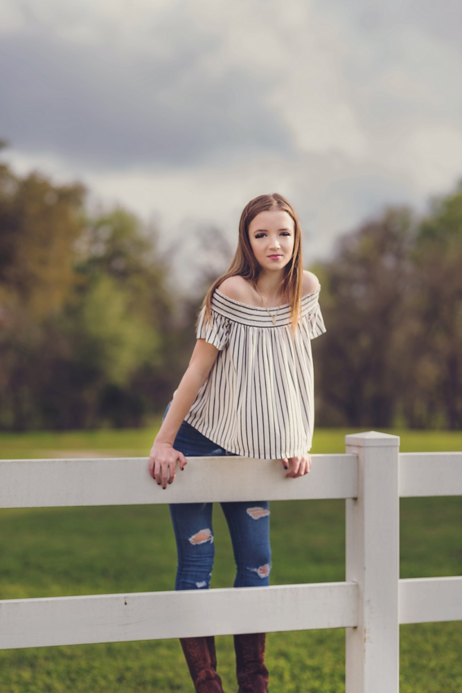 Creations by Jewel_white fence_Senior Photos_Girl.jpg