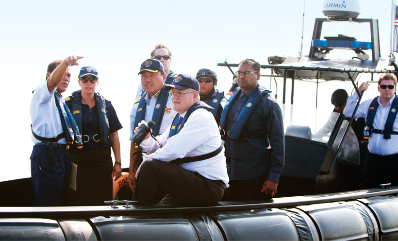 2014 - Former Australian Immigration Minister Scott Morrison on a vessel investigating hot spots for people smuggling off the Malaysian coast. Credits: Department of Foreign Affairs and Trade.