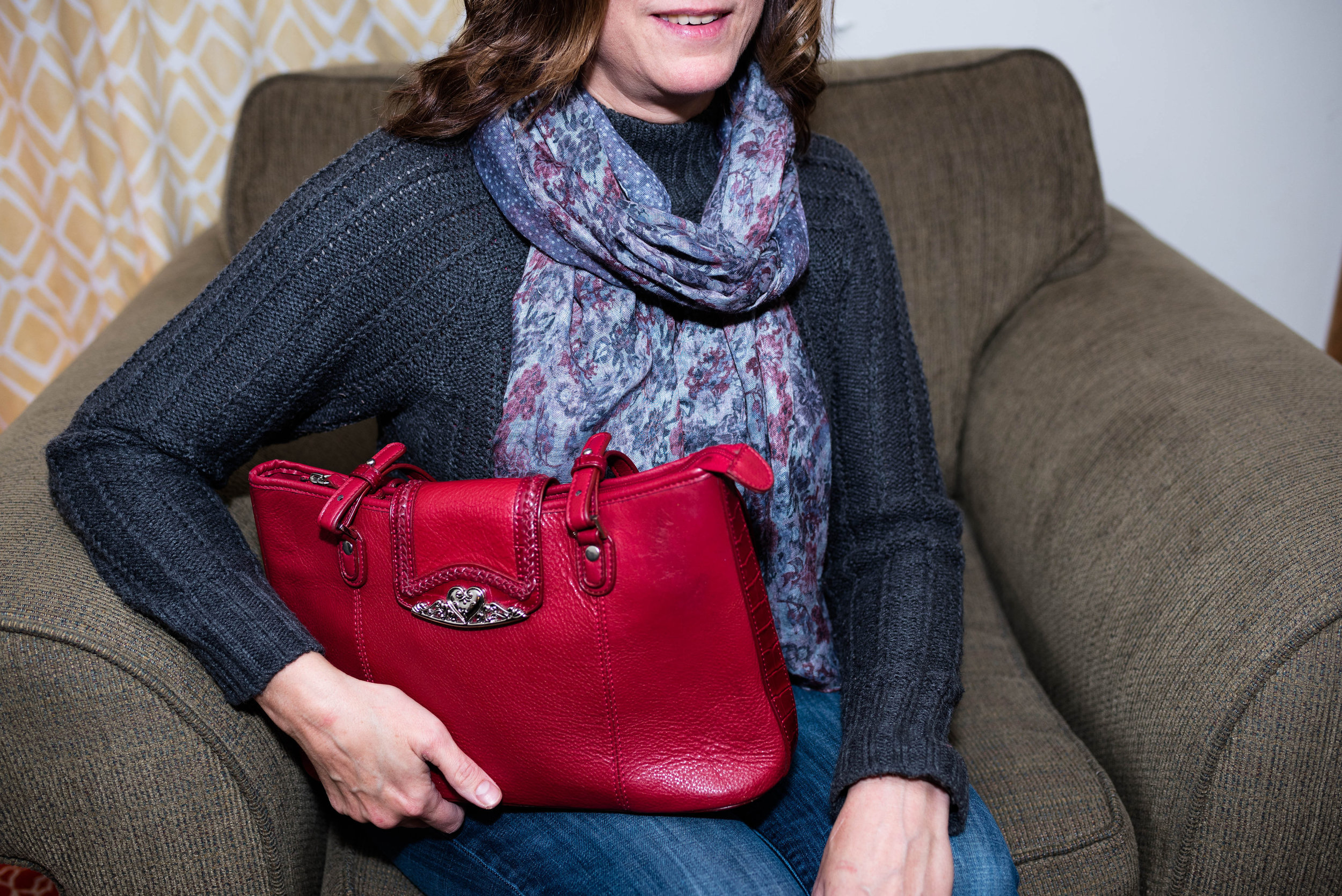 gray and red scarf with a red bag