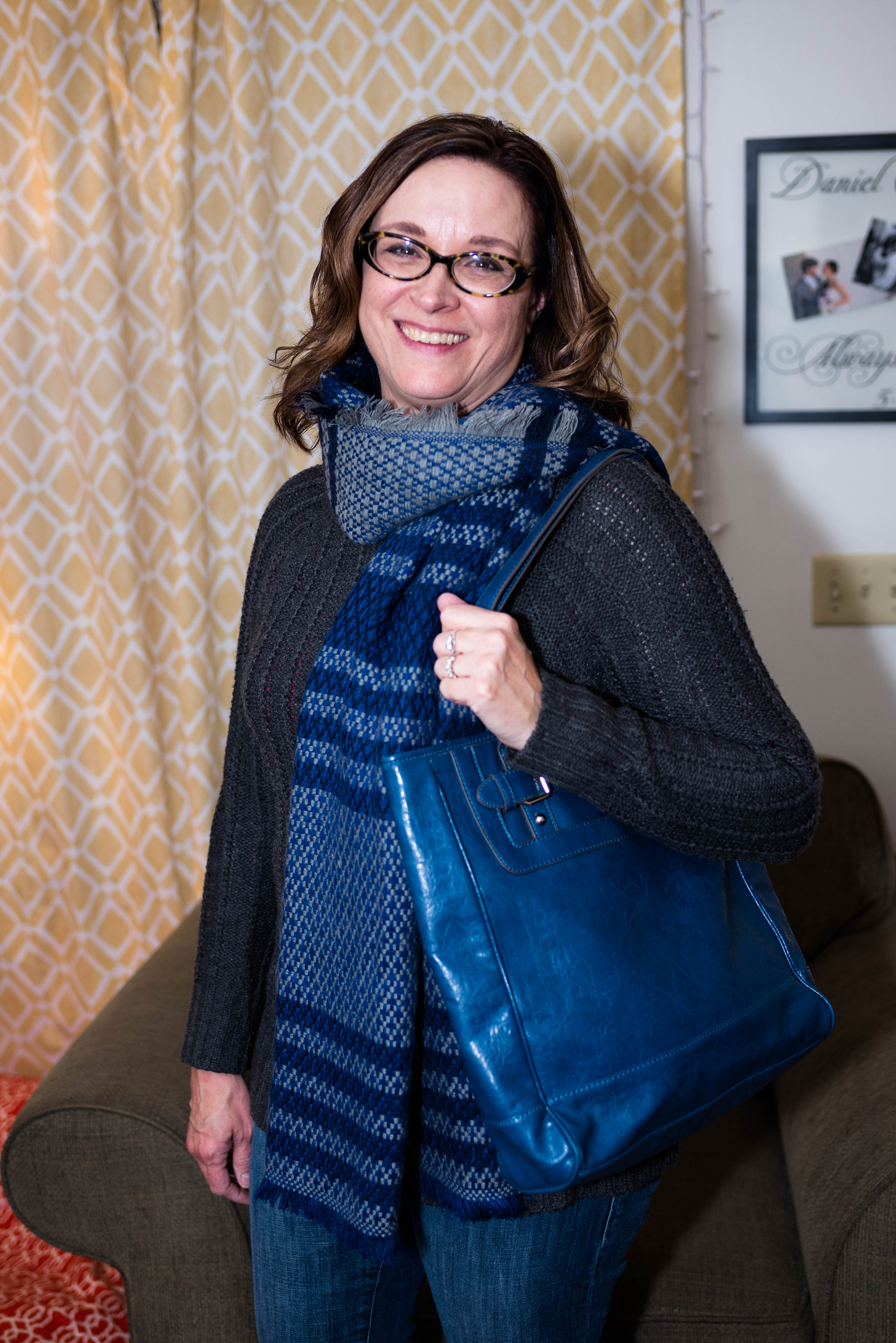 gray and blue scarf with blue bag