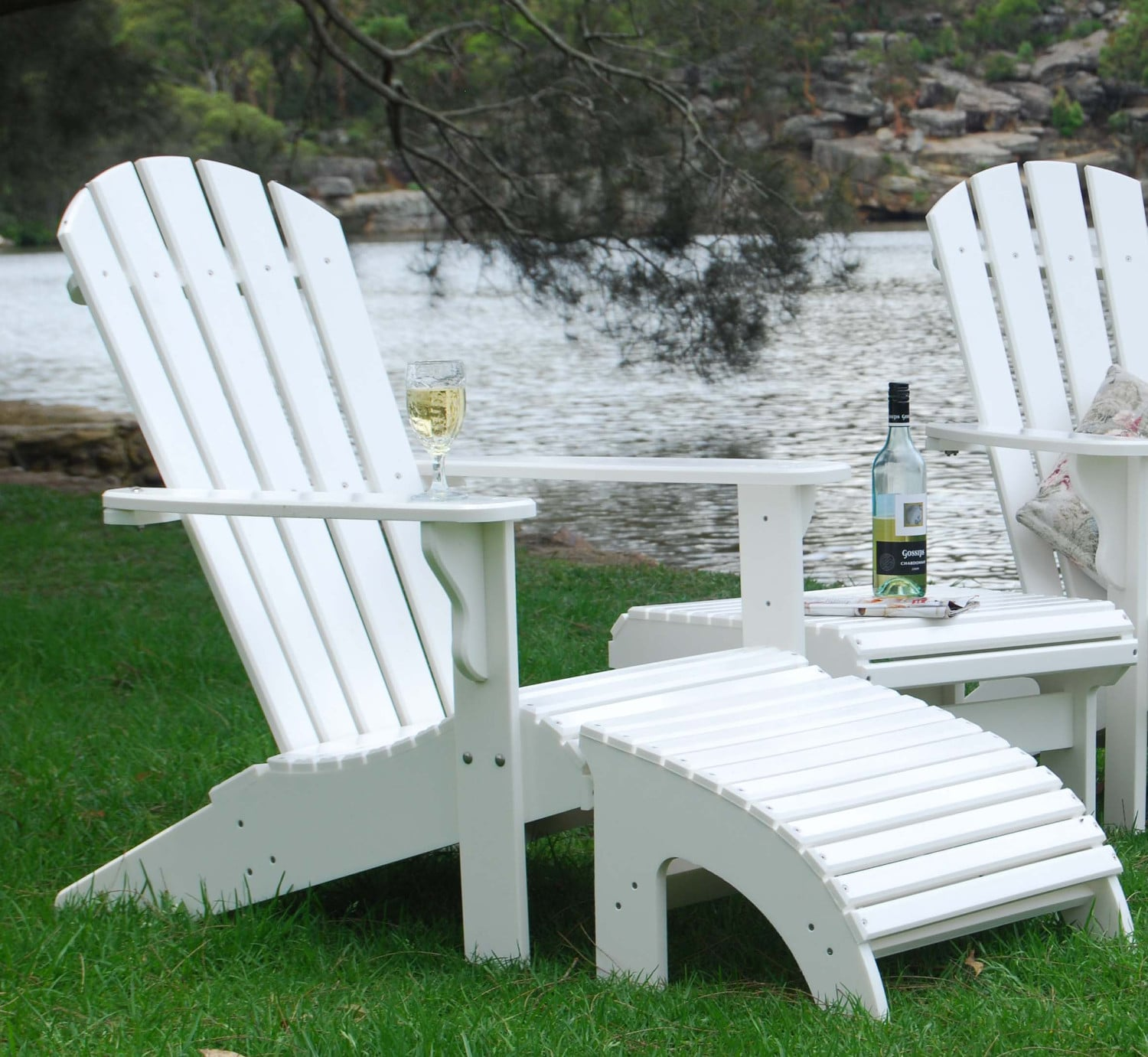 One Adirondack chair, one table and one footstool