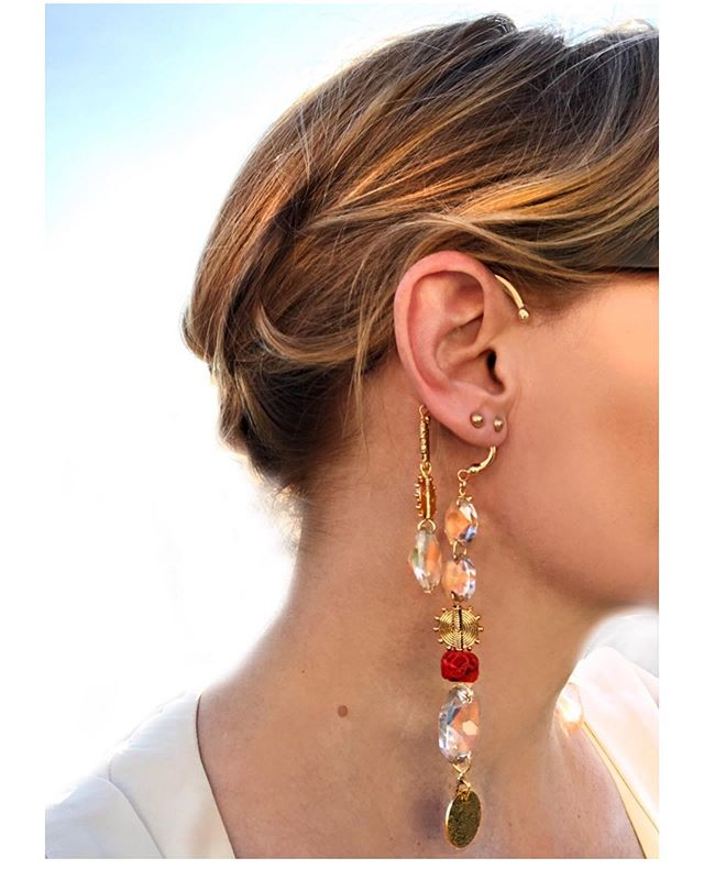 Handmade asymmetric chandelier earrings, actually made from crystals cut of an antique chandelier, that used to hang in my Swedish great aunts dining room. The crystals are interwoven with Sardinian coral and gold disk. Very fun to make and even more fun to wear. . . . #oneoff #handmade #coral #crystal #standout #partytime #chandelier #powerpiece