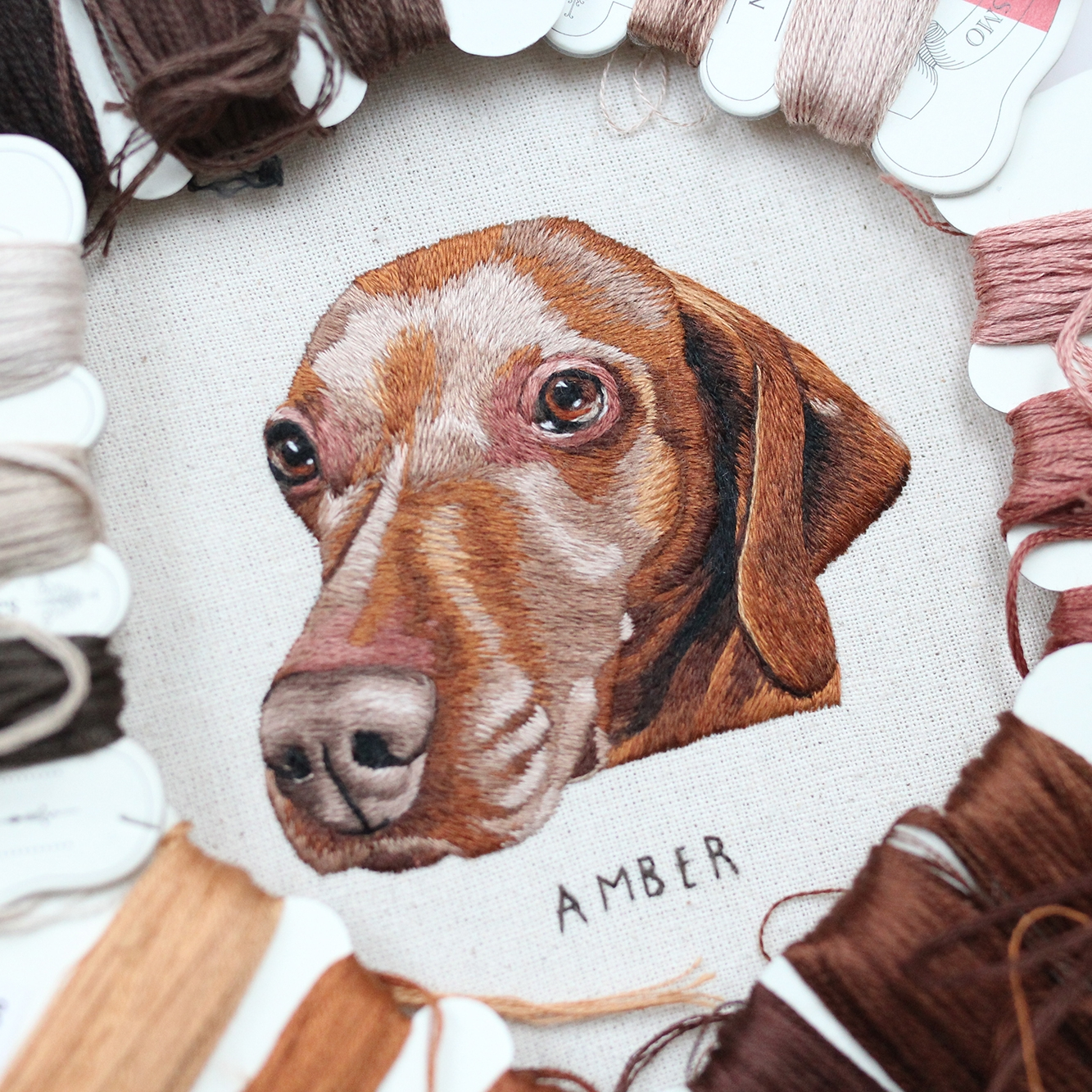 EMILLIE FERRIS - Emillie is a self-taught illustrator based in England. After completing her studies at University in 2015 she pursued a creative career in Embroidery, which she fell in love with during her 2nd year of study. After finding success through the social media platform Instagram, she has been able to embroider an assortment of pet portraits and woodland animals full-time. Emillie hopes to expand her business by embroidering people in the future, hosting workshops & taking part in fairs & exhibitions.