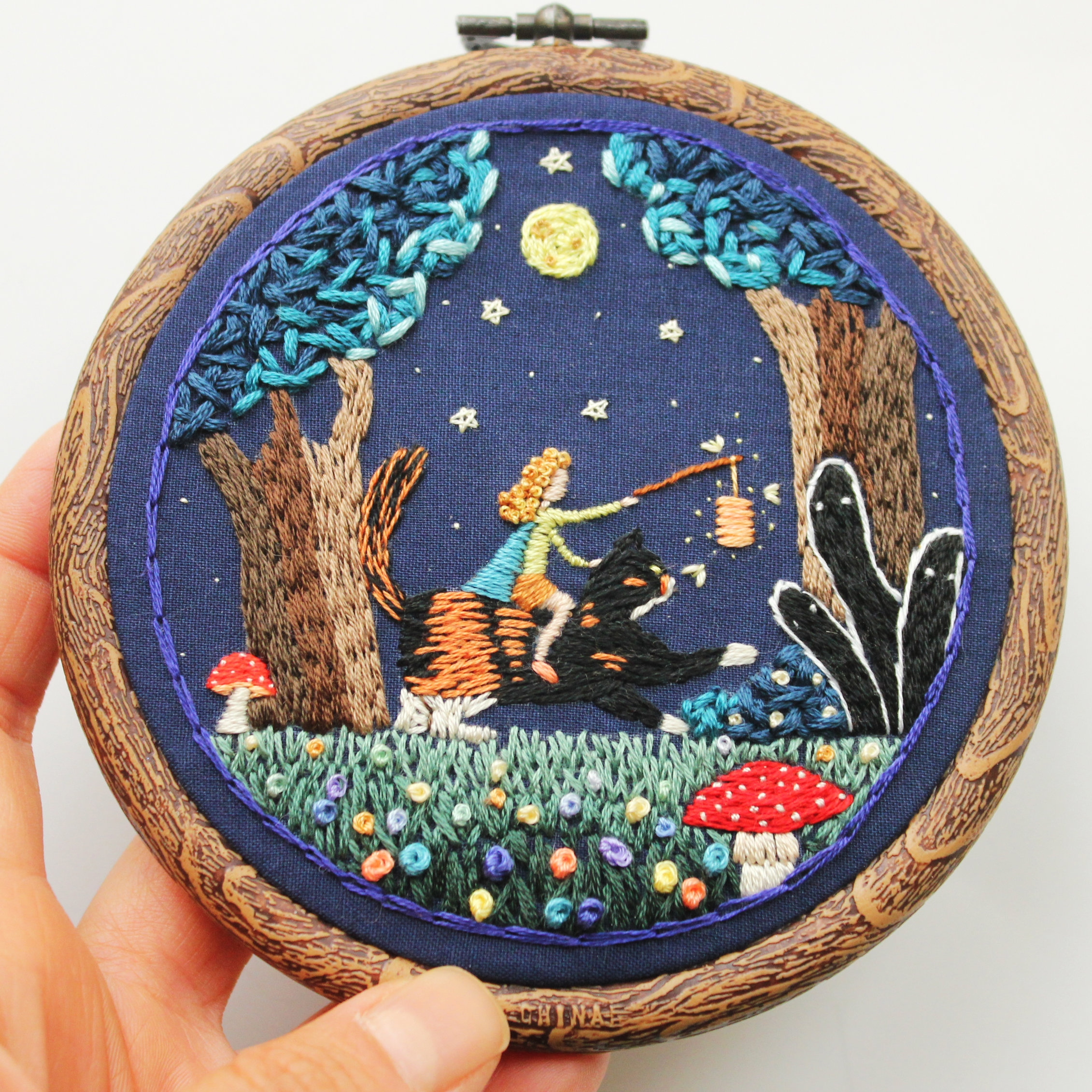 Irem Yazici - Irem Yazici is a self taught fiber artist based in Eskisehir Turkey. Her artistic journey began in 2014 with her interest in craft and she has kept exploring her artistic-self through the medium of embroidery.Her studio practice is divided into two parts: Making embroidered accessories such as pins and creating personal artworks. Her work is a combination of her illustration and embroidery practices, where she explores through color and texture. She creates worlds out of her surreal visions where magical things happen.