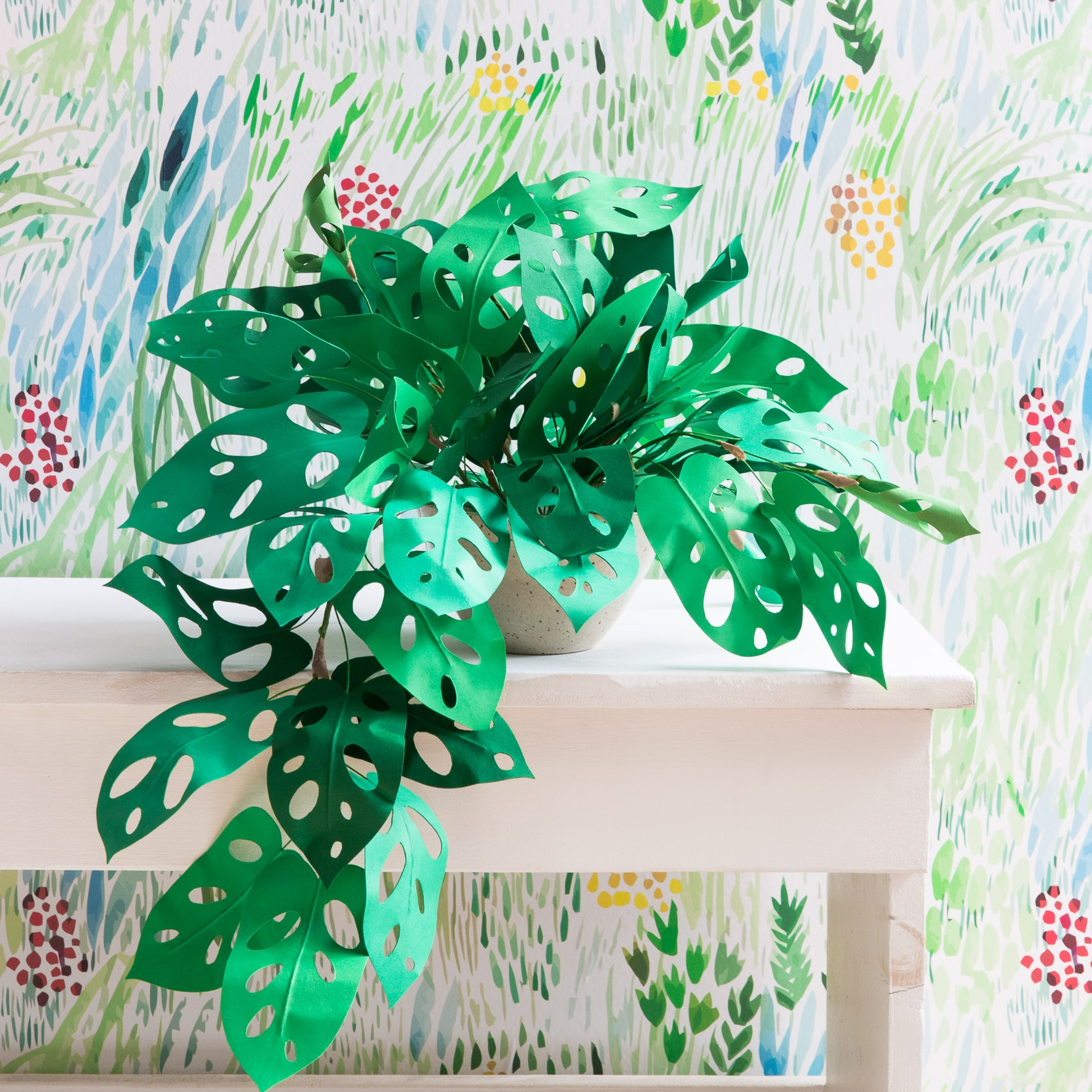 Corrie Beth Hogg + DIY Tutorial - Corrie Beth Hogg is a lifelong maker. She is currently crafting realistic plants out of paper, and has recently published a book on the subject entitled, Handmade Houseplants: Remarkably Realistic Plants You Can Make with Paper. Corrie has long been inspired by nature, from growing up near a national park to a season spent working the fields at an organic farm, she has always strived to integrate the natural world into her creative process. She studies plants, interpreting their visual signatures and details into digestible, clear steps, showing those with even the blackest of thumbs how to recreate them with paper.